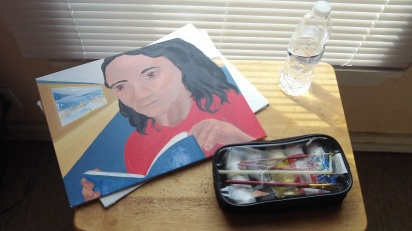 Pencil case with five basic colors of acrylics, a few different brushes, a rectangular mixing tray, a straw, a napkin. Plus a few canvas boards.