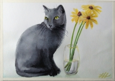A black cat sitting on the counter next to a water glass with three flowers. My signature has been simplified since we married in July.