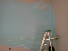 Early stage of mural with background color blocking and some under layers